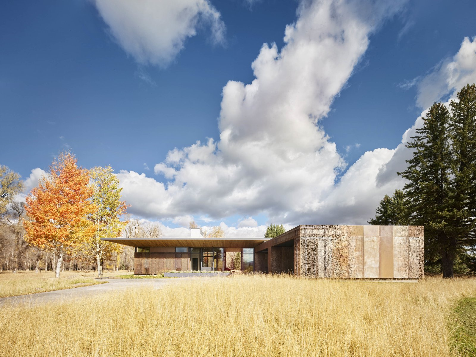 Exterior, Metal Siding Material, House Building Type, and Flat RoofLine From the outside, the screen reveals an earthy patina that is in natural dialogue with the wine silo.  Photo 8 of 11 in A Museum-Like Glass Pavilion Brightens a Sprawling Jackson Hole Estate