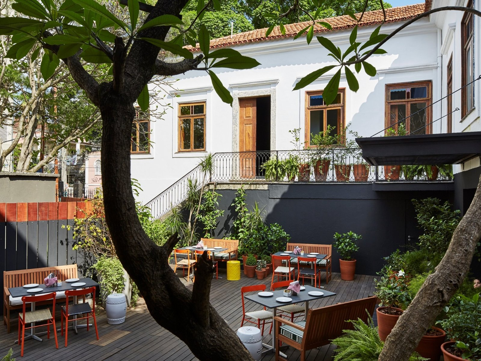 Outdoor, Metal Fences, Wall, Trees, Vertical Fences, Wall, Large Patio, Porch, Deck, Back Yard, Hanging Lighting, Decking Patio, Porch, Deck, and Raised Planters Mama Shelter Rio de Janeiro in Rio de Janeiro, Brazil  Mama Shelter Rio De Janeiro
