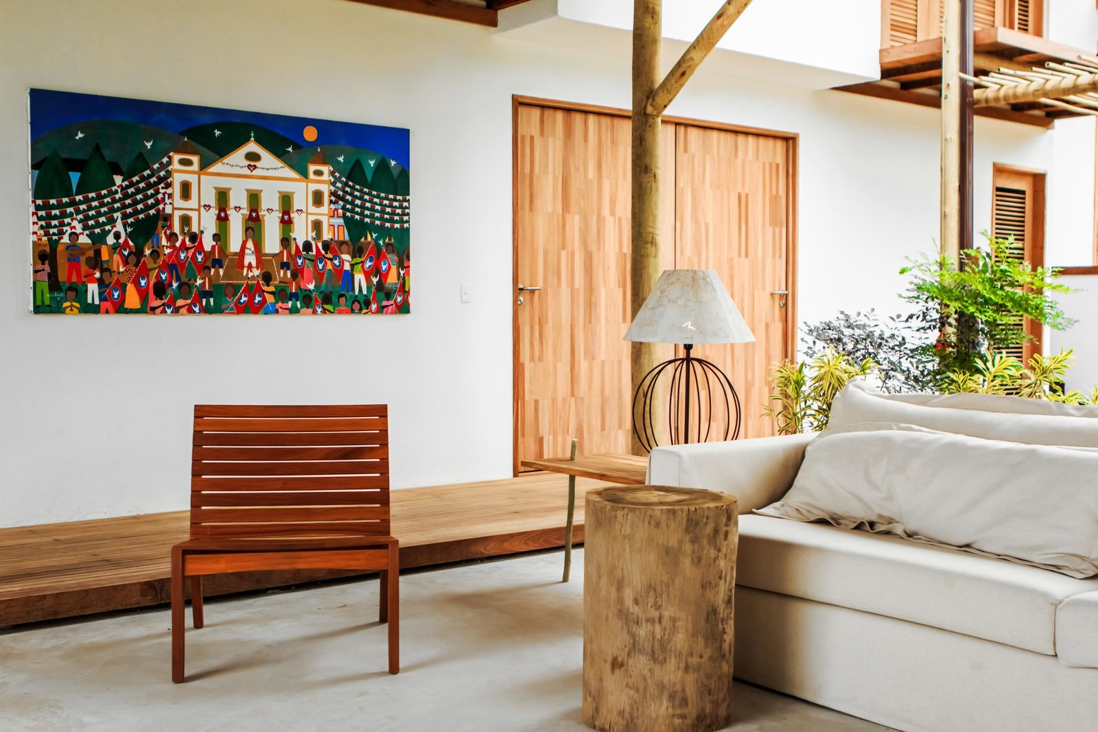 Living Room, Sofa, Chair, End Tables, Table Lighting, and Concrete Floor Casa Mar Paraty in Praia Grande, Party, Brazil  Casa Mar Paraty from 8 Brazilian Getaways to Book Now That U.S. Visitors Don't Need Visas