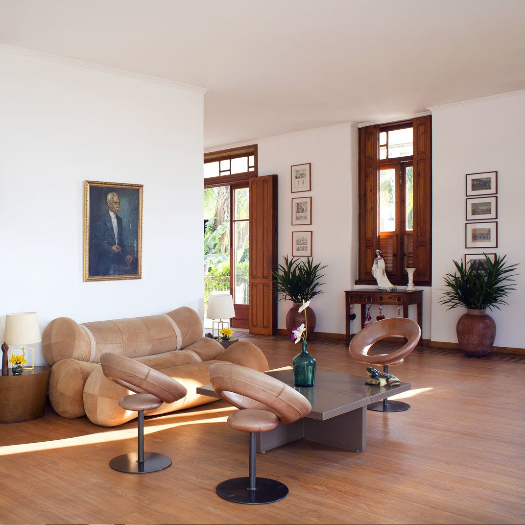 Living Room, Sofa, Coffee Tables, Chair, and Medium Hardwood Floor Mama Ruisa Boutique Hotel in Rio de Janeiro, Brazil  Mama Ruisa Boutique Hotel from 8 Brazilian Getaways to Book Now That U.S. Visitors Don't Need Visas
