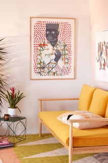 This trendy living room features an Urban Outfitters-exclusive print from artist and illustrator Camilla Perkins. Her work Gentleman With Egret inspired by renaissance portraiture in an ode to the vibrant textiles of the Congo's sapeurs.