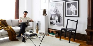 TRNK co-founder and CEO Tariq Dixon relaxes in his Brooklyn studio apartment.