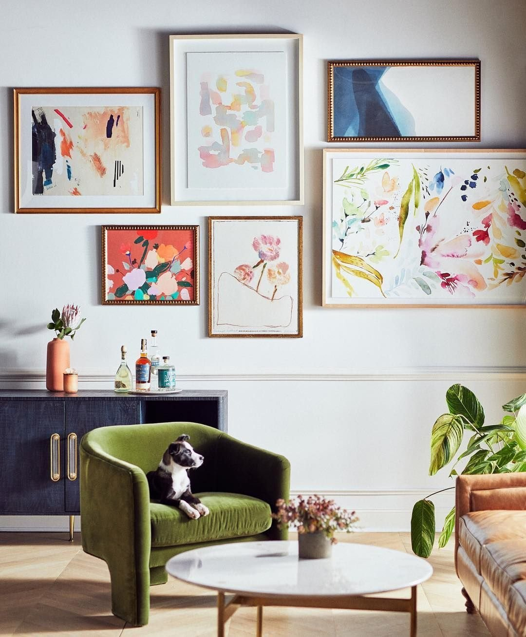 Living, Media Cabinet, Coffee Tables, Chair, and Light Hardwood Anthropologie's tailored art selection is vibrant and glamorous.  Best Living Photos from Shop the 12 Best Places For Affordable Art You'll Actually Want to Hang