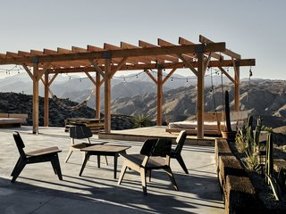 A cement slab and wood deck offer space for meals and stargazing. Sam built the furniture himself.