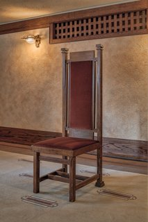 Original Wright furniture is on display in the home's dining room, main floor guest room, and third floor.