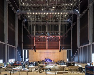 Blackout shades drawn over The McCourt create an auditorium setting.