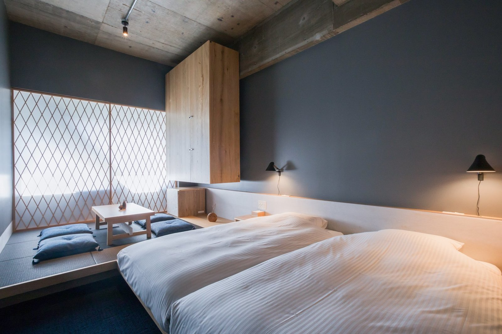 Bedroom, Bed, Wall, Track, Rug, Carpet, and Storage The Share Hotels Kumu Kanazawa in Kanazawa, Japan  Best Bedroom Bed Rug Carpet Wall Photos from 10 Alluring Places to Stay in Japan Under $300 a Night