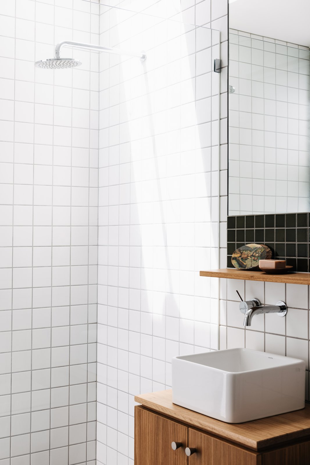 Bath Room, Wood Counter, Vessel Sink, and Corner Shower The guest bathroom features Waringa tiles from Johnson Tiles and a Caroma basin.  Photos from This Light-Filled Bungalow Exudes Playful Tree House Vibes