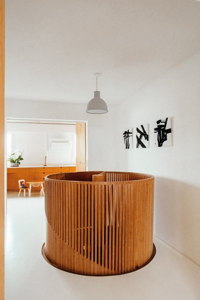 The previous owners had created the duplex by linking two apartments  with a spiral staircase. A pendant lamp by Muuto now overlooks the staircase, which has been reinvigorated with a new birch plywood surround.  The material is a unifying motif:  The shelves and cabinets  designed by Delaunay, including those in the kitchen, are made of it.