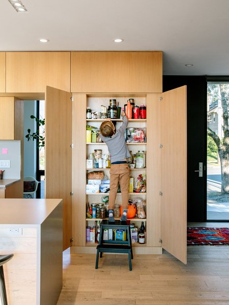 The white oak casework, which goes from floor to ceiling throughout much of the kitchen, was fabricated by Big Branch Woodworking for $22,000.