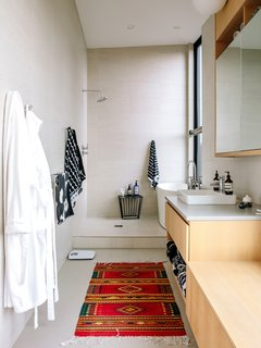 The master bathroom features a Vox sink by Kohler outfitted with an Essence faucet by Grohe. Marimekko towels hang from the walls.