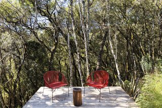 Chairs by Guilherme Wentz for Cremme sit on the deck.