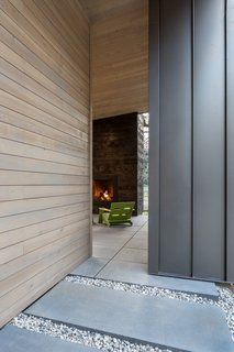 Stepstone's Large Scale CalArc pavers seamlessly transition from inside to outside and from walkway to patio.