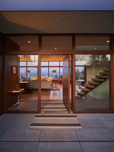 The original entryway, conceived as an aperture to view beyond, was updated with more glass. The street-facing exterior was bumped out four feet toward the road to create additional space.