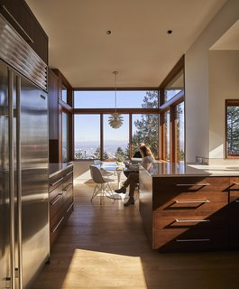 """After removing the original roof, the architects boosted the ceiling height on the ground floor to accommodate clerestory windows. """"We took a fairly heavy roof structure and lifted it up,"""" says Miller. Now the breakfast nook enjoys better light and a wider view on three sides."""