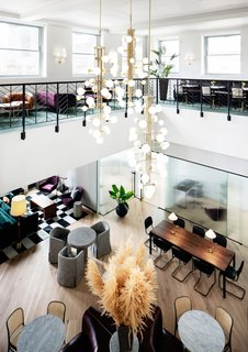 Sprawling across 22,000 square feet, the vast Bond Station House showcases 25' ceilings in the main lounge and features an array of custom built meeting areas and communal spaces. Gorgeous natural light pours in throughout from the wraparound penthouse terraces.