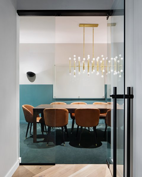 A peek inside one of the many conference rooms at Bond Station House. Inspired by old-world aesthetics and lasting modernism, the co-working space beautifully merges timeless design with plush, new-age details.