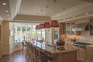 The house features a large eat-in kitchen, fitted with custom cabinetry and modern appliances.