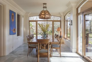 Right off the kitchen is another spacious, light-filled dining area.