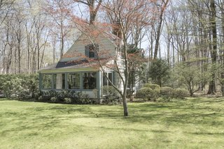 The sale of the home also includes a 2,400-square-foot cottage, which even comes with its own garage. This quaint space can easily be converted into a guest house, or a creative studio.