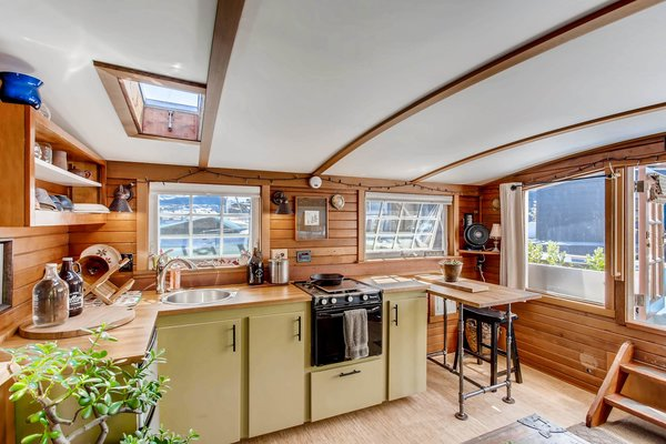 The quaint yet highly functional kitchen features butcher block countertops, as well as a skylight which allows natural light to seep inside.