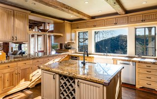 A look at the French country kitchen, fitted with an abundance of modern amenities.