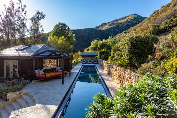 Featuring a gym/pool house and gorgeous grassy lawns, the spectacular estate also includes not one, but two ocean-view pools.
