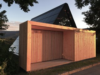 The freshly revamped A-frame features a solar-paneled roof and an innovative timber entryway.