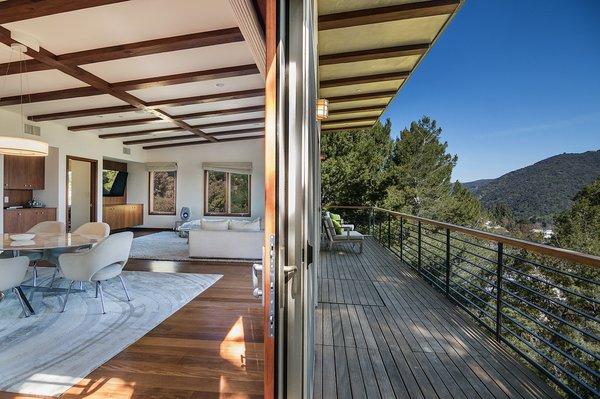 A spacious deck beautifully frames dramatic canyon and city views.