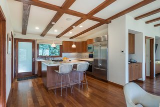 The kitchen is equipped with new, high-end appliances, and is located right off the living room.