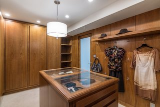 The master suite also includes a spacious walk-in closet with walnut cabinetry.