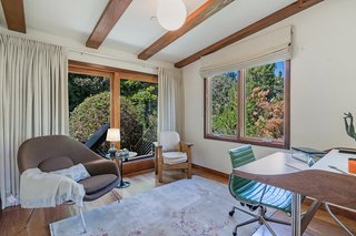 Wide windows and sliding doors allow for an abundance of natural light to flood inside.