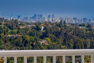 Perched atop a canyon in Brentwood, the home offers striking city views in the distance.