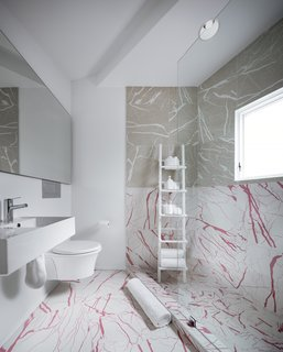"In the bathroom, the ceramic tiles sport a marble faux finish, while other rooms have vinyl or engineered composite tiles with faux terrazzo, wood, or ""drawing"" finishes."