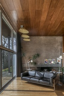 """The living area—or """"dance floor,"""" as the Womersley family called it—has an expansive feel, thanks to high ceilings and full-length windows."""
