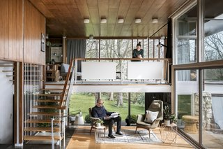 "The couple purchased the living room's H.W. Klein chairs with the house. Another existing piece was the mezzanine's daybed, designed by Peter Hvidt and Orlando Mølgaard Nielsen. An original floating staircase leads to the mezzanine and then up to the second floor. The open, straight-forward spaces speak to one of Christian's guiding principles: ""Simplicity is the key,"" he says."