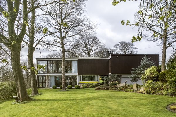 The Farnley Hey house in West Yorkshire has undergone many changes since Peter Womersley designed it in 1954. Christian Harvey and Victoria Davies, the current owners, are working to update the house—and undo some of the previous alterations, including removing the greenhouse inserted under the cantilevered second floor—while staying true to its original aesthetic.