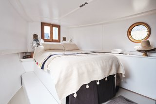The bedroom houses a fitted double bed and wardrobe, as well as an integrated, stainless-steel fresh water tank.