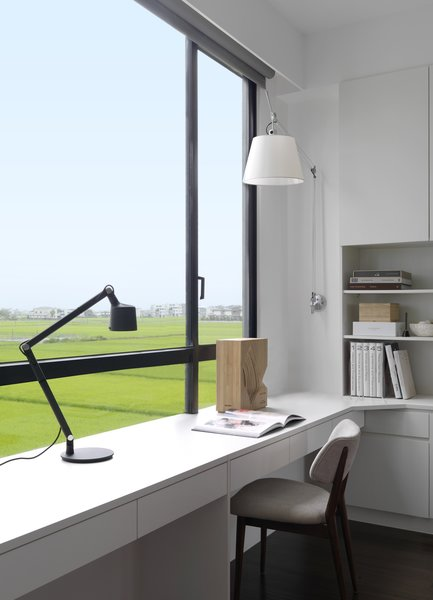 The desk lamp is from Vipp and the chair and wall lamp were designed by André.