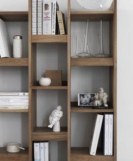 Danish vases, vintage Michelin figures, and cookbooks fill the Originals Furniture Singapore bookshelf.