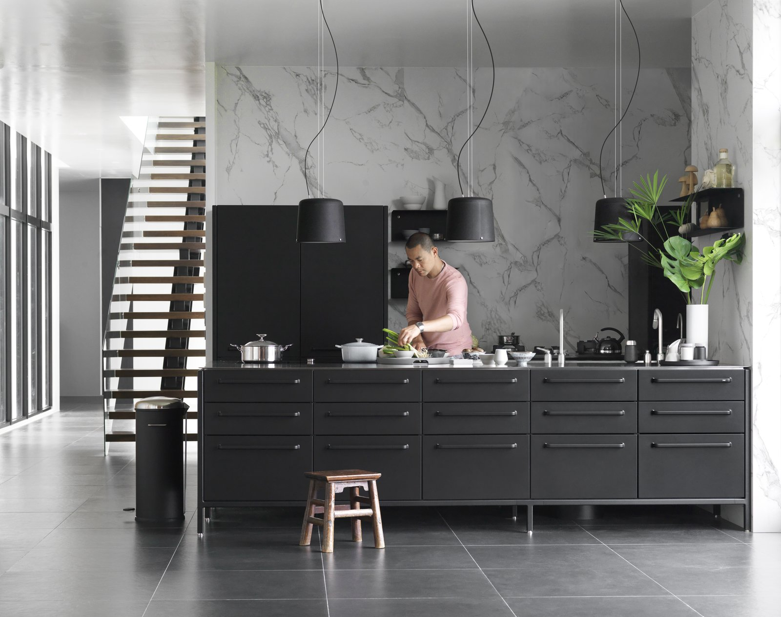 Kitchen, Marble Backsplashe, Metal Counter, and Metal Cabinet Two of chef André Chiang's restaurants have appeared on the annual World's 50 Best Restaurants list. So it makes sense that at his new home in Taiwan, which he largely designed himself, the kitchen takes center stage. To outfit it, André worked with Vipp, the maker of everything from the black steel island and stainless-steel countertops to the faucets, cabinets, shelves, pendant light fixtures—even the tea kettle and trash bin.  Photo 1 of 21 in Michelin-Starred Chef André Chiang's New Home in Rural Taiwan