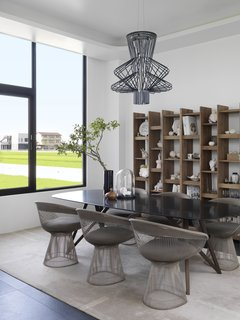 The dining chairs are by Warren Platner for Knoll.