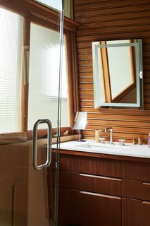 The master bathroom features custom mahogany cabinets and a Caesarstone countertop.