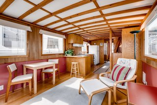 The boat's midcentury-inspired interior features beautiful exposed wood beams.