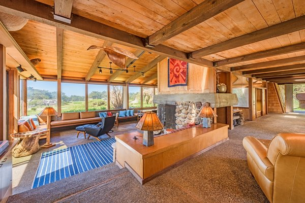 At the core of the home is a magnificent stone fireplace. The warmth of natural woods line all of the living spaces, and bold art forms rooted in the natural world complement the lodge-like atmosphere of the great room.