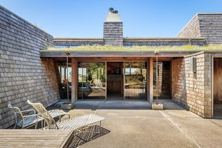An interior landscaped courtyard provides an idyllic spot for enjoying an alfresco meal.