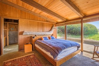 Like other areas of the home, nature provides the theme for the light-filled master suite.