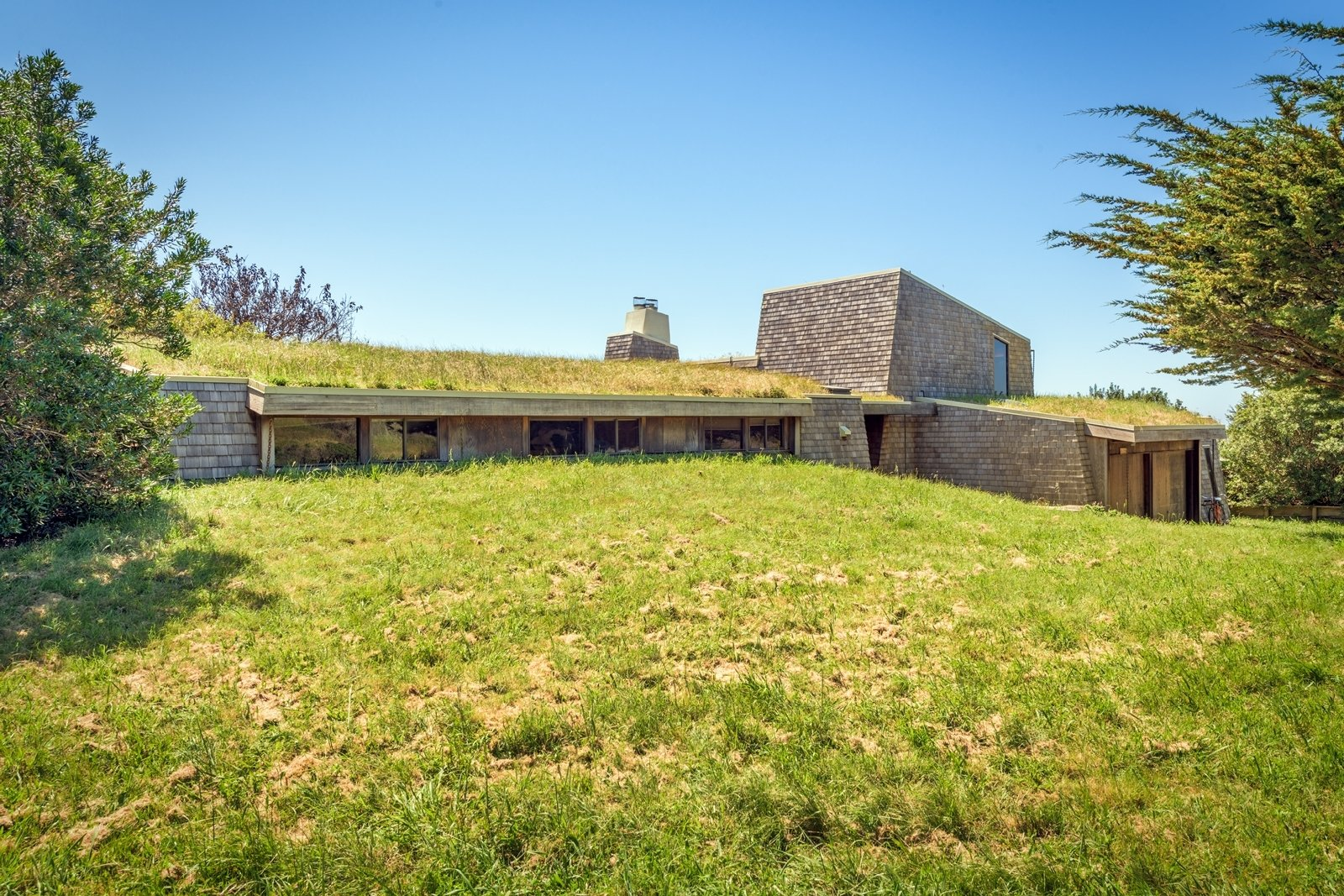 Exterior, Shingles Roof Material, House Building Type, and Wood Siding Material The property is just a short stroll from a network of interconnected trails.  Photos from A Sea Ranch Stunner With a Green Roof Asks $1.3M