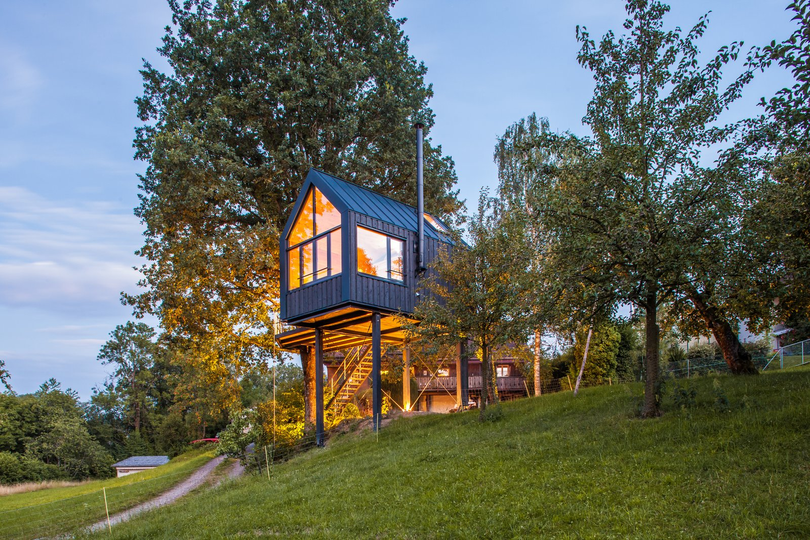 Exterior, Gable RoofLine, Prefab Building Type, Treehouse Building Type, Metal Roof Material, House Building Type, Wood Siding Material, and Tiny Home Building Type The petite prefab cabin only took eight days to assemble once arriving to Switzerland.  Best Photos from This Prefab Tree House Took Just 8 Days to Assemble