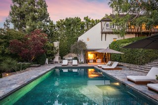 Lush landscaping encircles the backyard, creating a tranquil setting with plenty of privacy.
